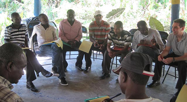 SIS professor Anthony Wanis conducts peace conversations in Haiti with several men