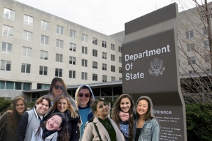 The anti-gang initiatives team is photoshopped in front of the Department of State.