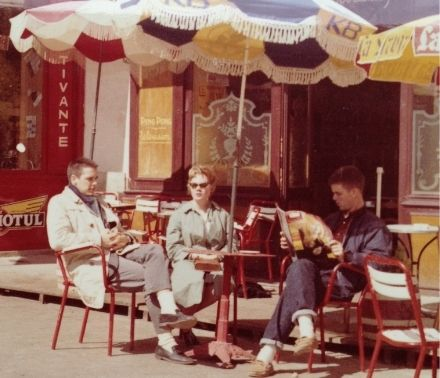 Gordon Adams sits outside a café in France.