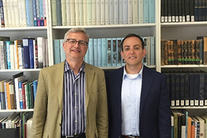 Assistant Professor Guy Ziv on right and Professor Michael Brenner, director of American University's Center for Israel Studies in front of bookshelf.