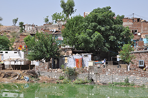 View of slum settlement from a river in India.