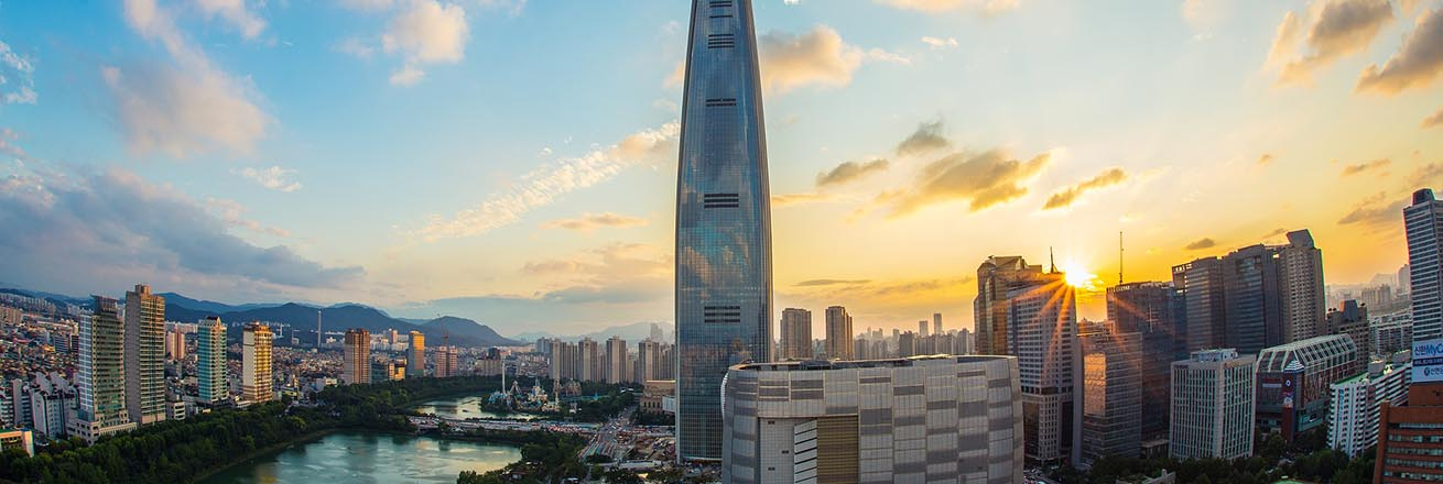 Seoul skyline at sunset featuring the 123-floor super skyscraper