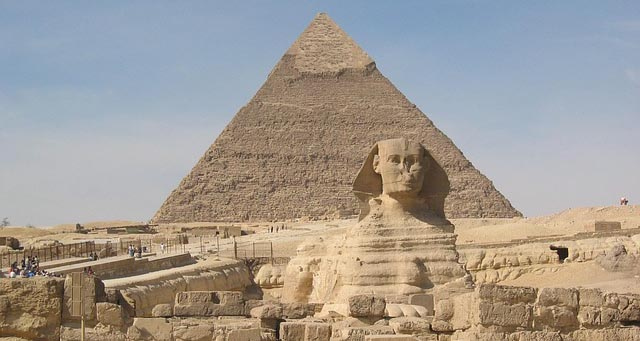 Sphinx with one of the Great Pyramids of Giza behind it