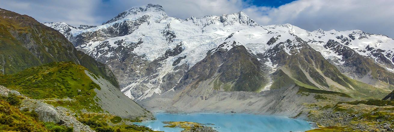 snow-covered mountains and bright blue lake of New Zealand