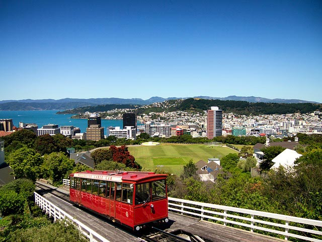 trolley going uphill and overlooking the beach and city of Wellington