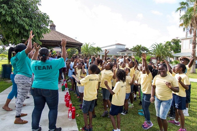 Youth participants and team leaders engage in an outdoor activity in the Bahamas