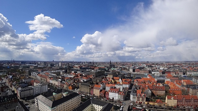 Aerial of buildings in downtown Copenhagen, Denmark on a partly cloudy day.