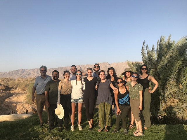 The 2018 practicum team with Professor Eric Abitbol smiling under the blue sky in Israel.