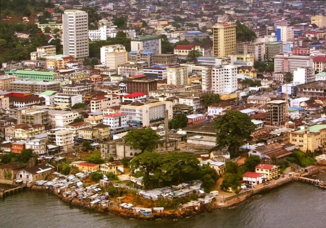 Aerial Image of buildings in Freetown Sierra Leone near a coast line on a cloudy day.