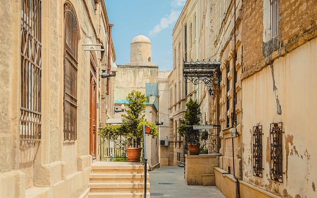 roaming the tan-colored ancient streets of Baku