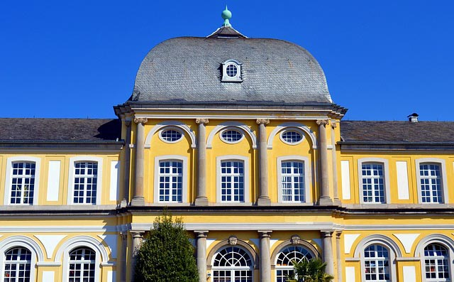 exterior of the detailed yellow windows of the Poppelsdorf Palace on the University of Bonn campus