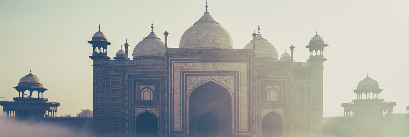 the ornate Taj Mahal glows in the early hours of the morning