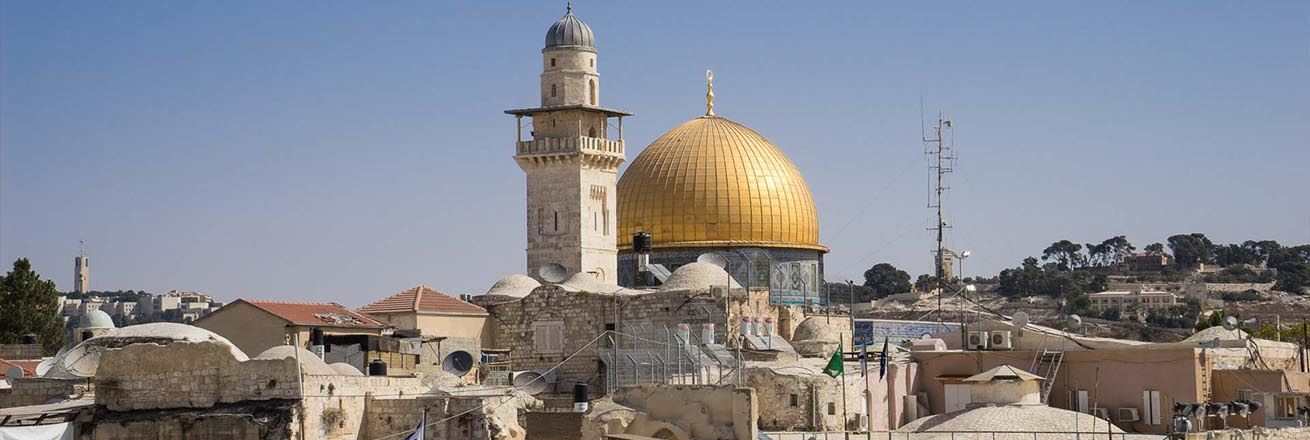 looking out across rooftops and signature golden domes of churches in Jerusalem