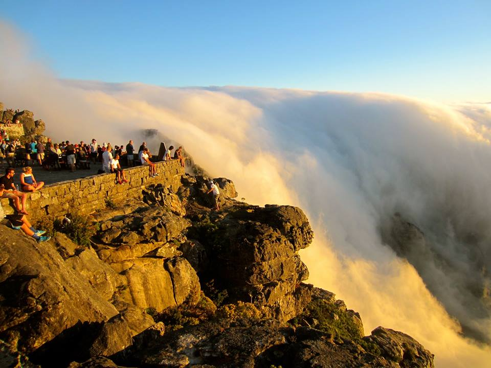 "Sunset on Table Mountain (Cape Town, South Africa) with a waterfall of clouds draping over the ""table"""
