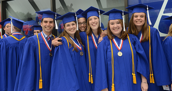 group of SIS honors graduate students in their commencement regalia