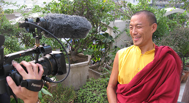 A Buddhist monk being interviewed on camera