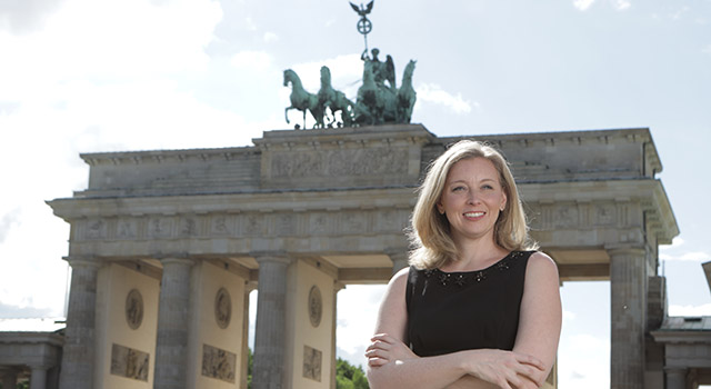 International Media graduate Melissa Yaeger stands in front of the Brandenburg gate in Berlin.