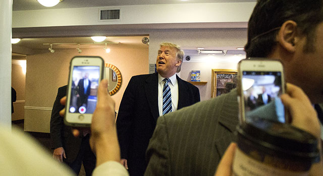 Students photograph Donald Trump with their cell phones during campaign event