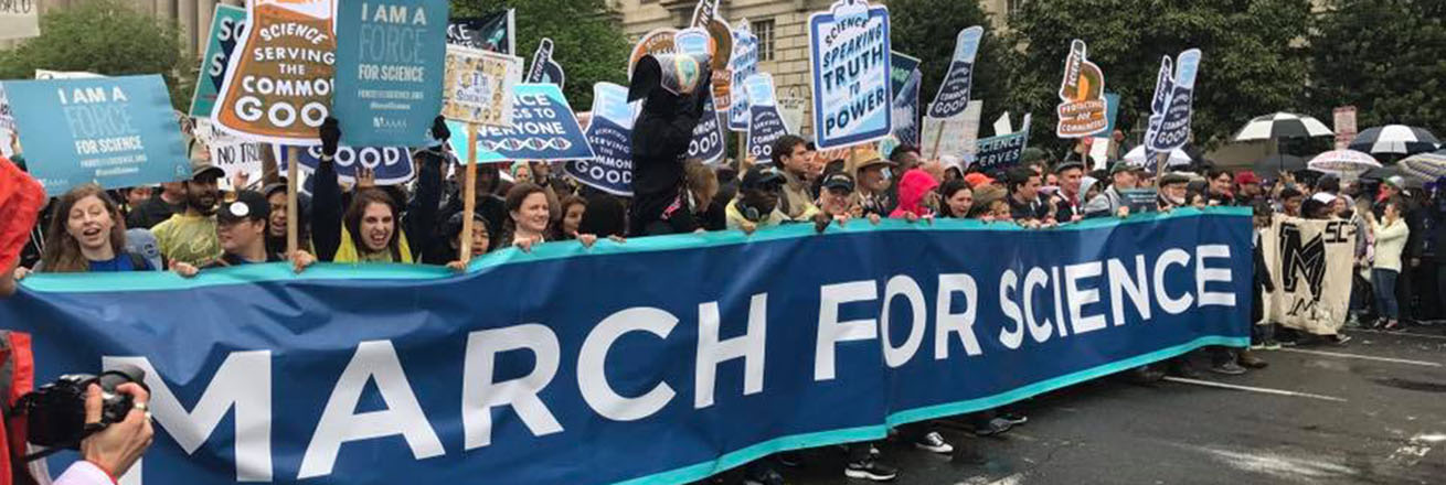 Marchers in Washington DC behind a March for Science banner