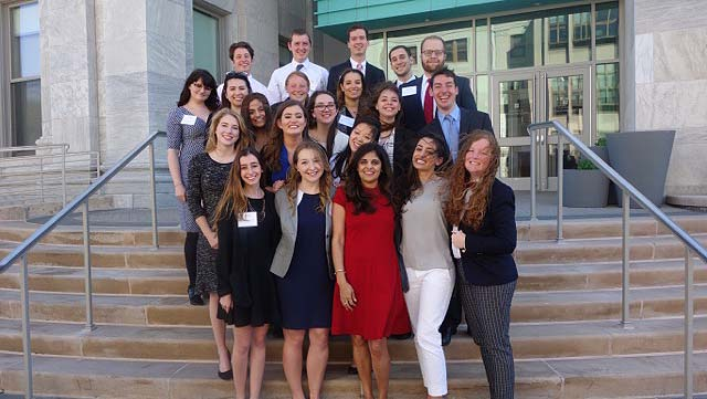 Spring 2016 PR Portfolio class stands in front of the McKinley Building
