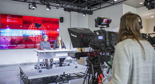 Two student anchors during filming of District Wire news show