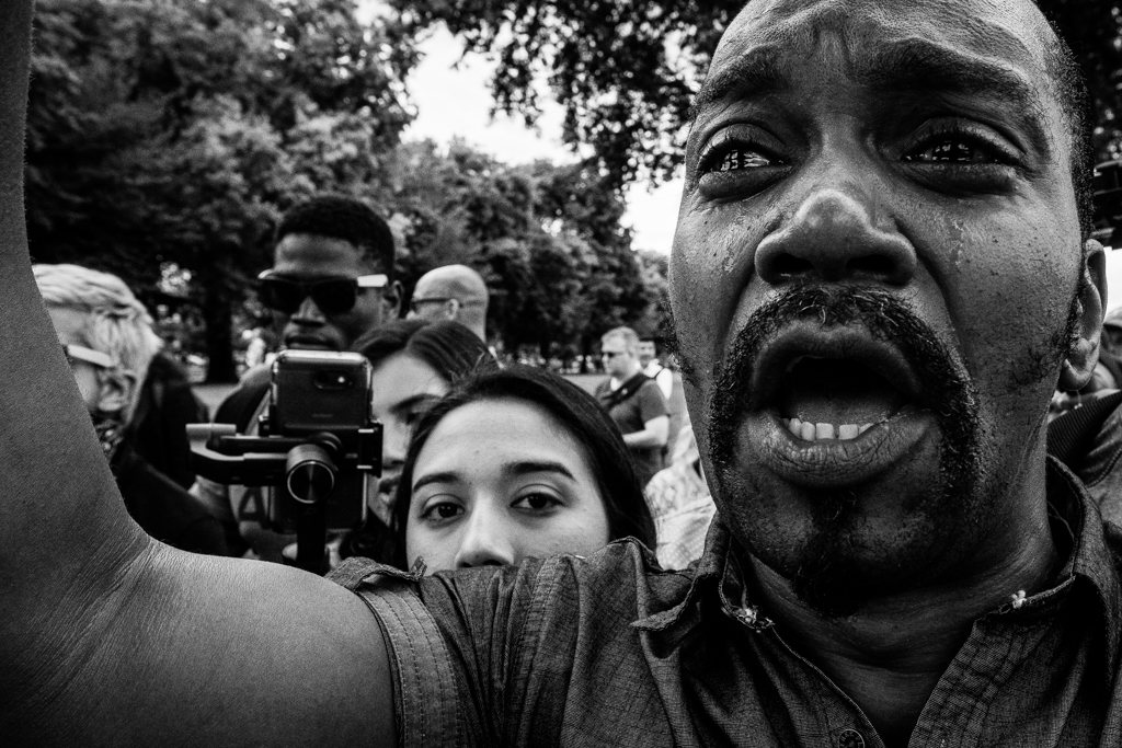 Protest violence brings tears to the eyes of a man witnessing a clash between Antifa and the Proud Boys in Portland, Oregon. AUG 17, 2019. Photo/Eric Elmore