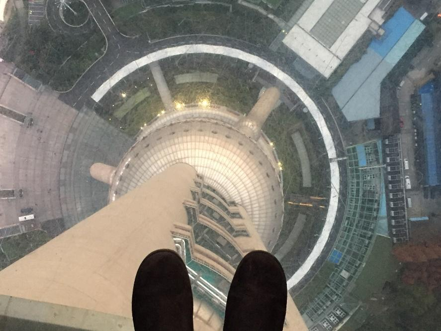 Japaira Ellison standing inside the Pearl TV Tower looking down.