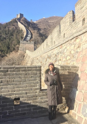 Japaira Ellison stands at the Great Wall of China.