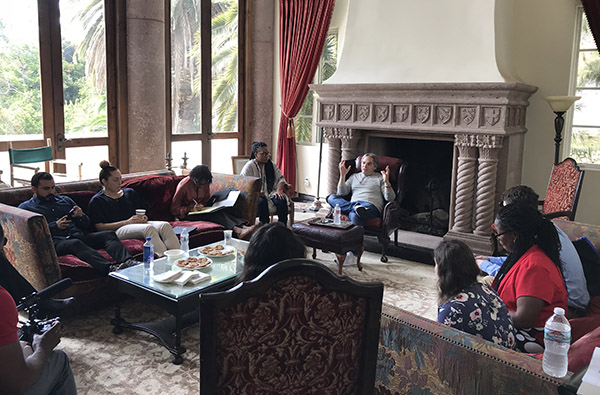 Adam Goodman meets with L.A. Intensive participants in the AU West mansion.