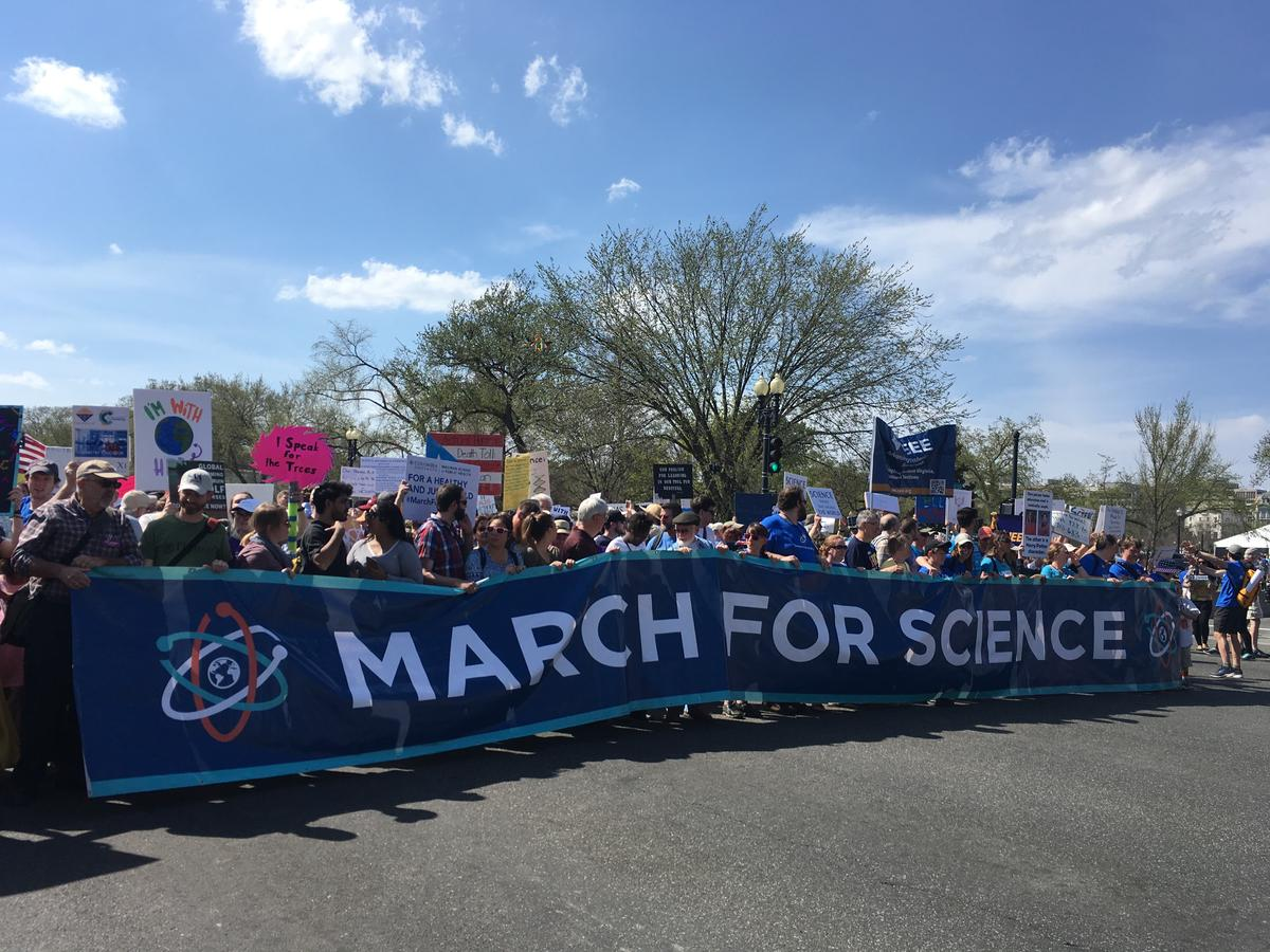 Crowd gathers holding March for Science sign