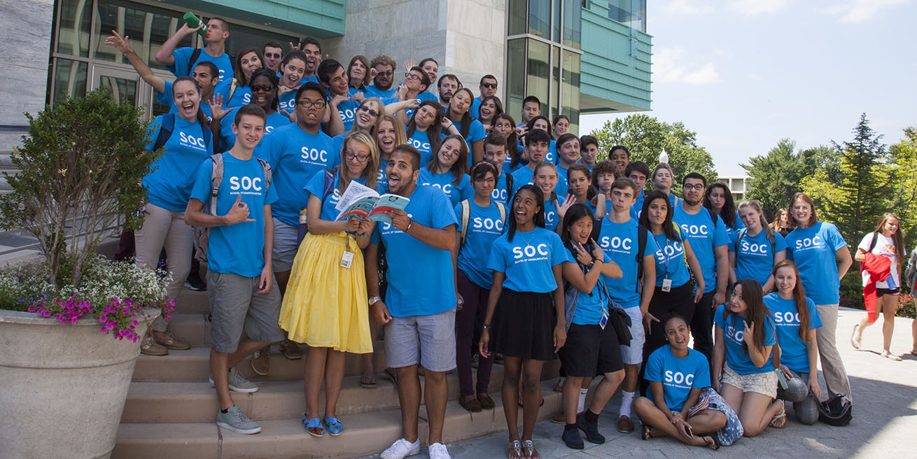Large group of SOC Ambassadors pose outside the McKinley building.