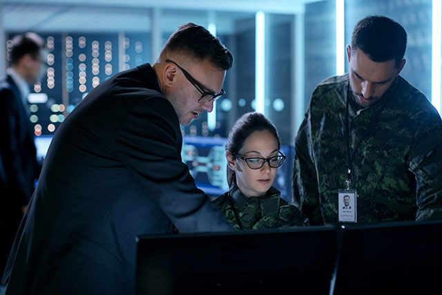 Military members working on cybersecurity task