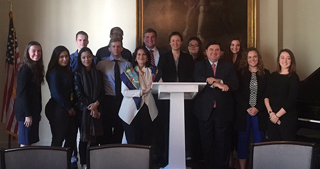 Anita McBride, center, with a group of Reagan Fellows at the Decatur House.
