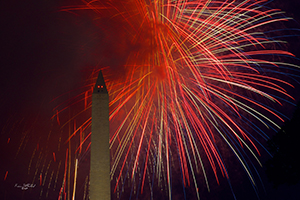 Fireworks erupt behind the Washington Monument at Night (Kevin Sutherland, 2013)