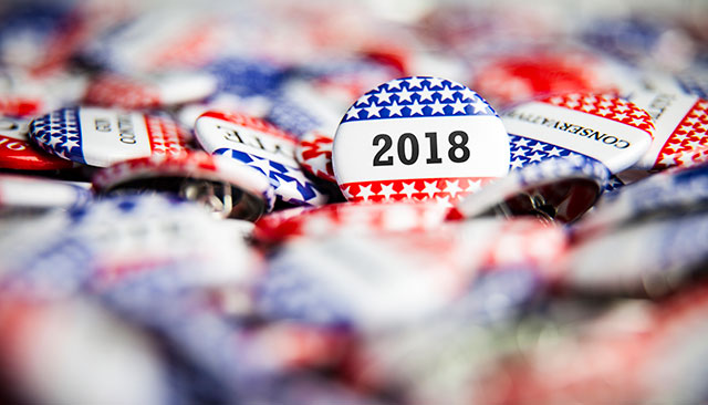 Various 2018 voting buttons and pins