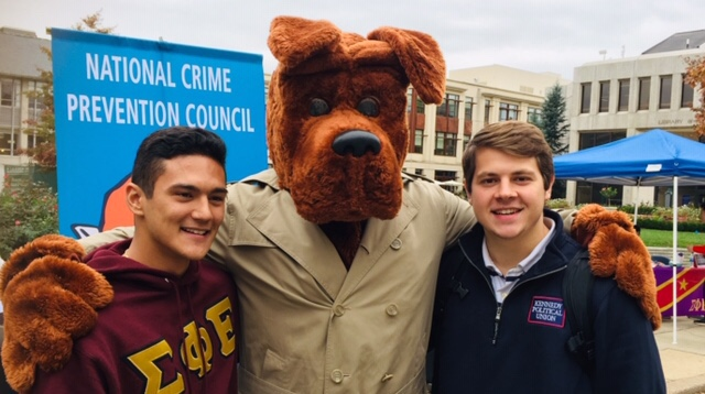 McGruff the crime fighting dog with two AU students