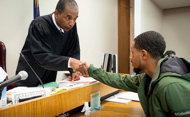Judge shaking hands with citizen