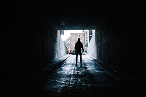 person standing in tunnel