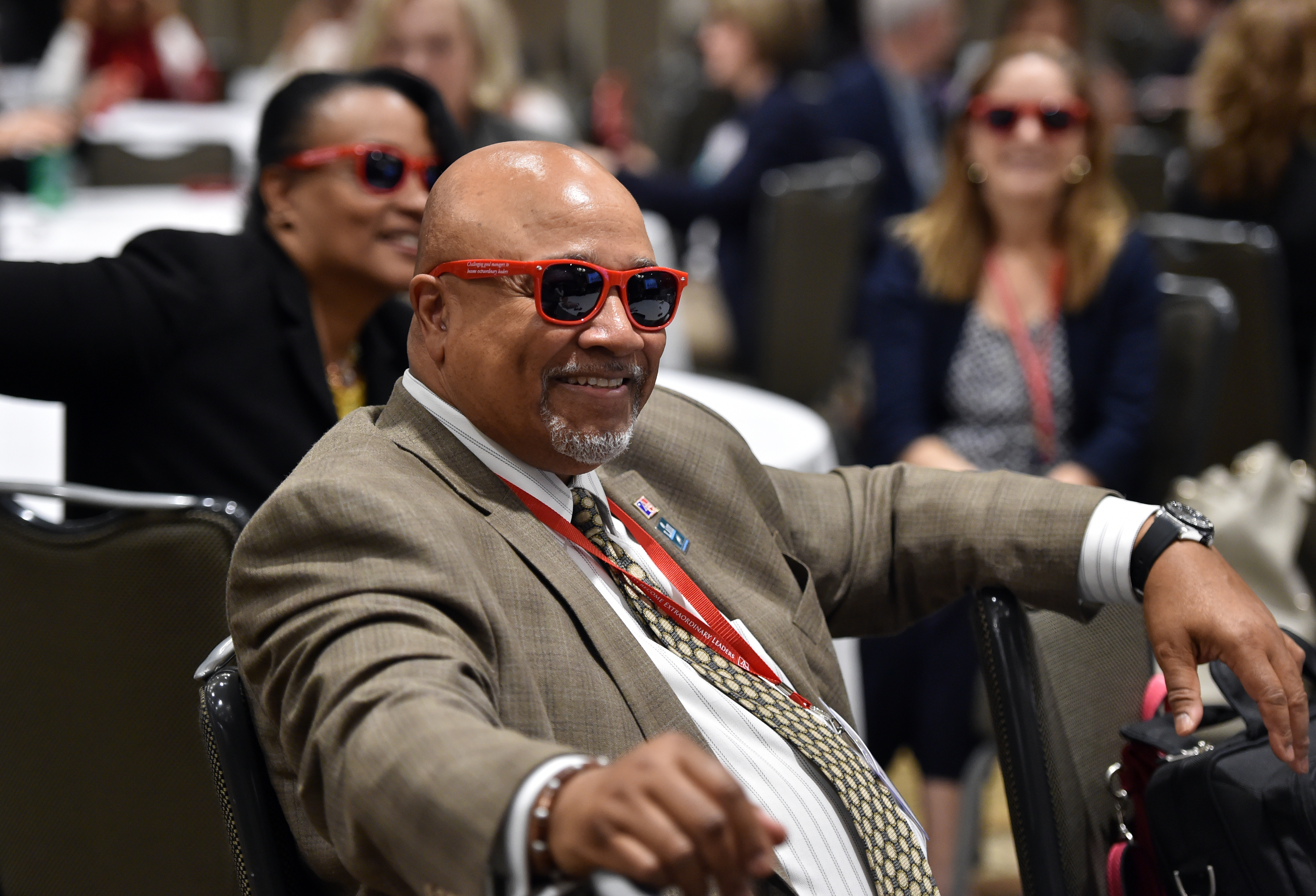 Reg Wells listens to a presentation during the 9th Annual Key Conference