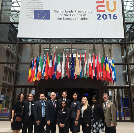 Key Cohort 50 poses in front of the EU flags in Brussels.