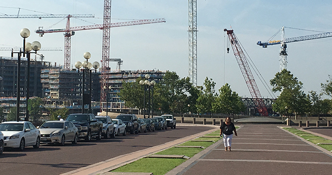 Cranes tower above new DC development projects under construction.