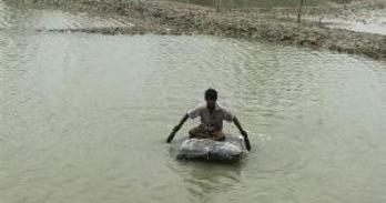 Person paddling through flooded area