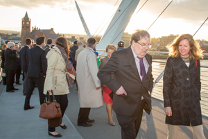 Cowell-Meyers walking across the peace bridge with John Hume