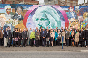 The entire delegation at the Douglass Mural on the Peace Wall in West Belfast