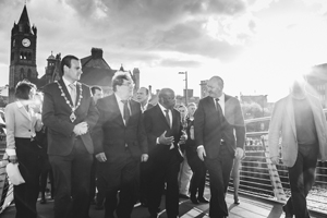 Martin Reilly, Lord Mayor of Londonderry; Noble Laureate John Hume; Rep. Lewis; and Mark Durkan, MP for Foyle, cross the peace bridge in Londonderry/Derry