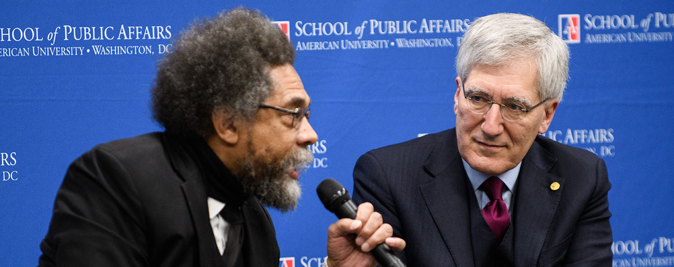 Cornel West and Robert George speaking at event