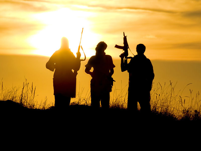 Silhouette of Three Foreign Fighters