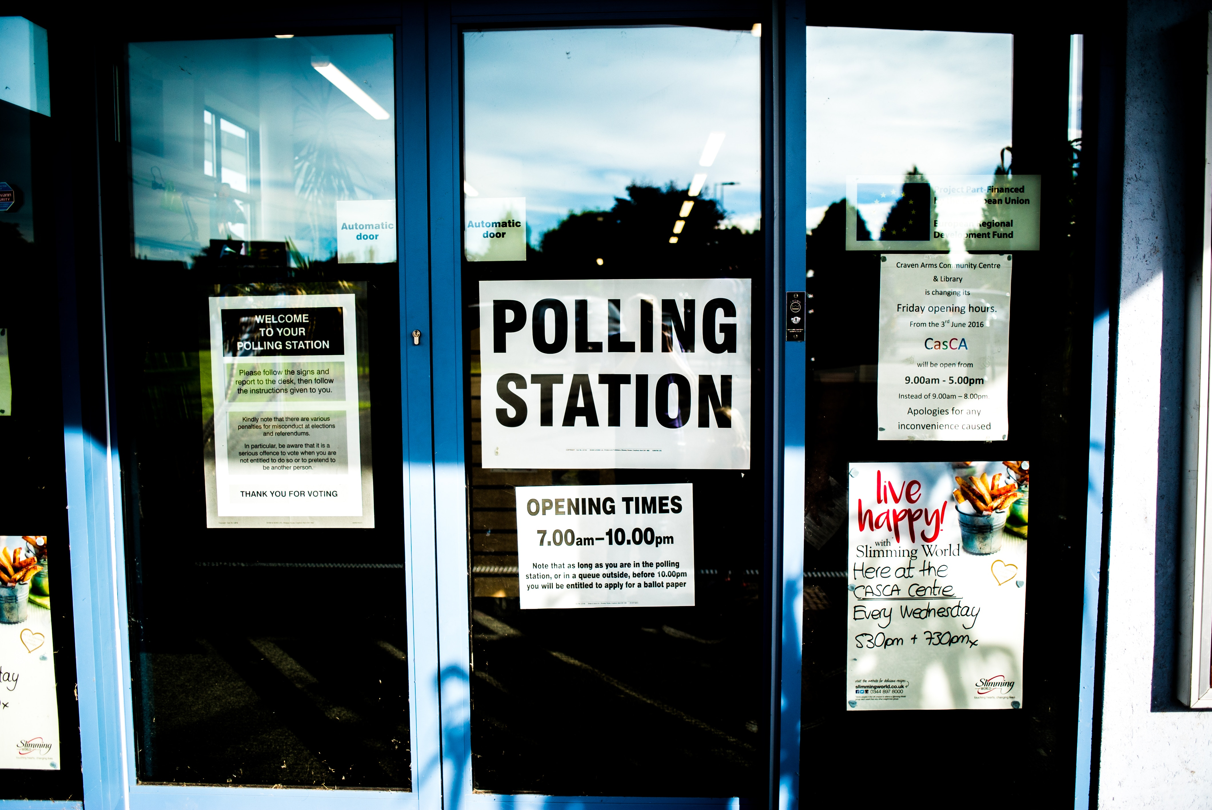 Photo of a polling station with a sign that says polling station