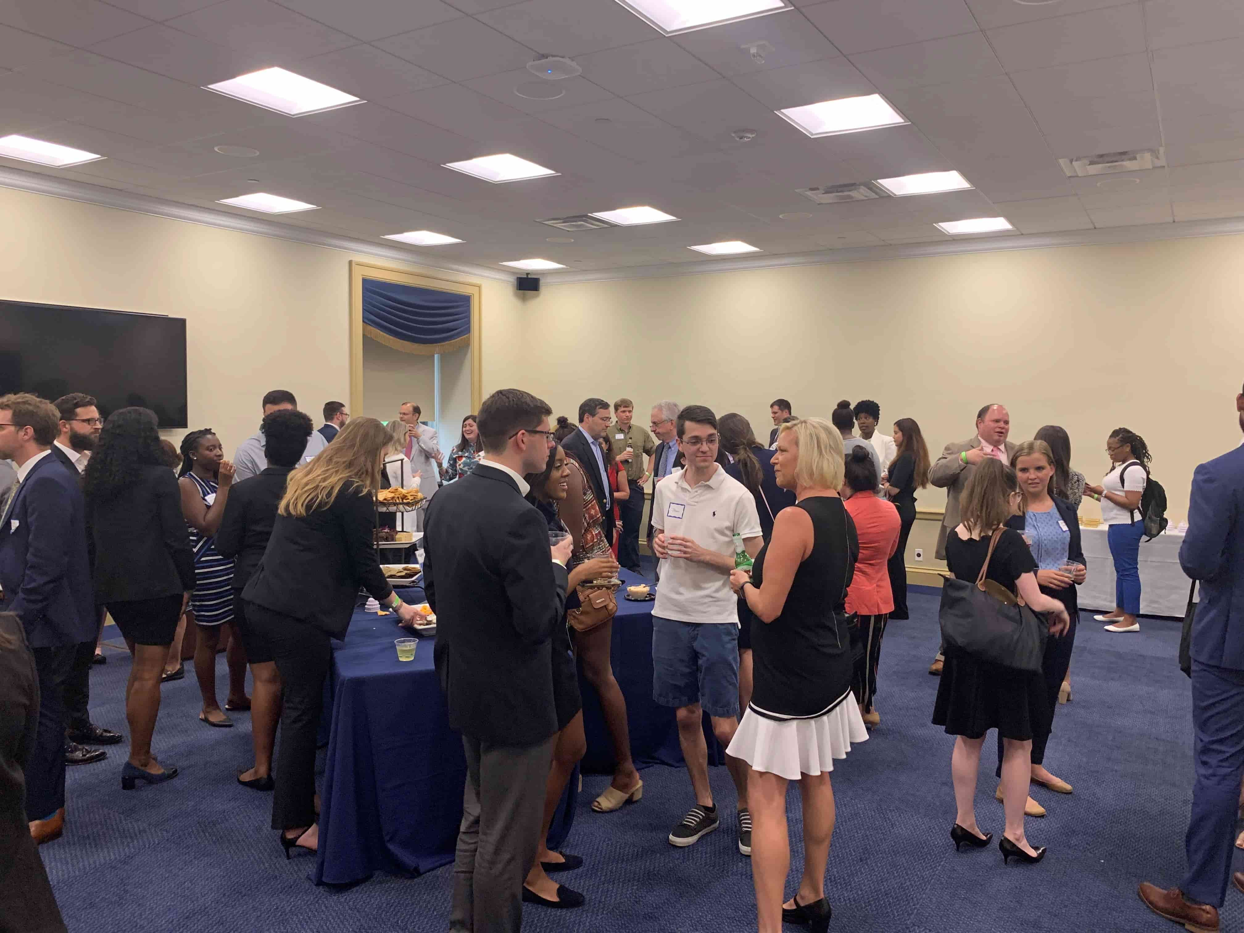 Attendees of the Happy Hour on the Hill event mingle with snacks and drinks