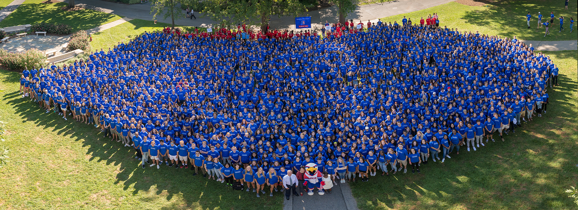 The entire incoming class poses with the Provost, the VP of Campus Life, and Clawed Z. Eagle